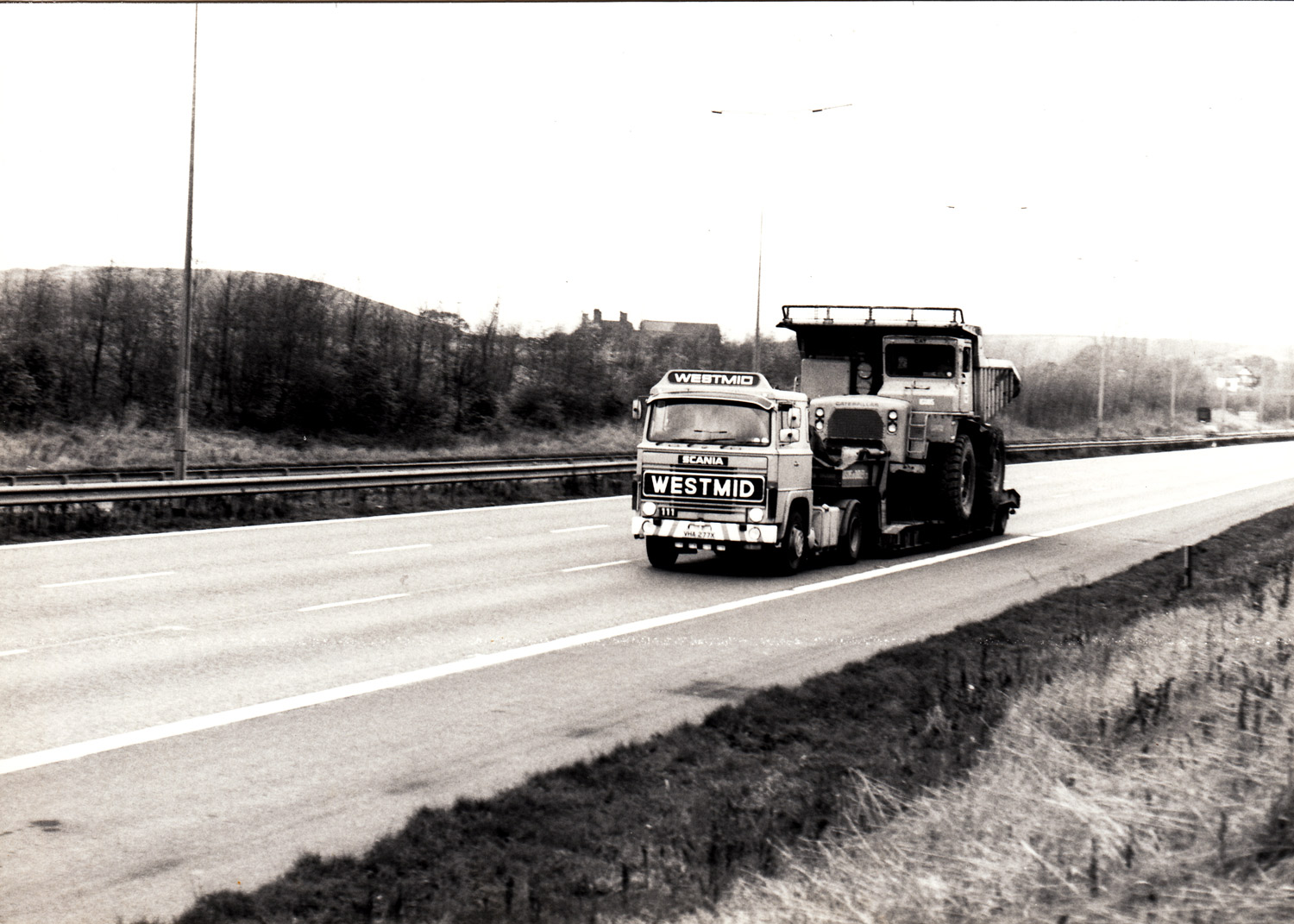 Westmid's first introduction to Scania with this LB111, seen here on a heavy haulage trip from Scotland to South Wales with a Hudsons of Dudley trailer.