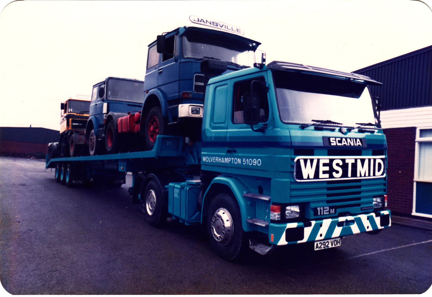 Westmid tractor unit with state-of-the-art sliding deck recovery trailer (well it was state-of-the-art at the time). Note it is carrying three tractor units as the trailer had a technical dispensation on overall length, discovered by Chris Kelly, and exploited to the full to benefit the company, collecting multiple trucks bought at auction etc, especially from Scotland. The trailer was fitted with an incredibly powerful diesel driven remote control 'donkey' winch which was fitted underfloor between the landing legs. This was designed by Chris and John Plant (of PCM, Northants), an incredibly talented engineer.