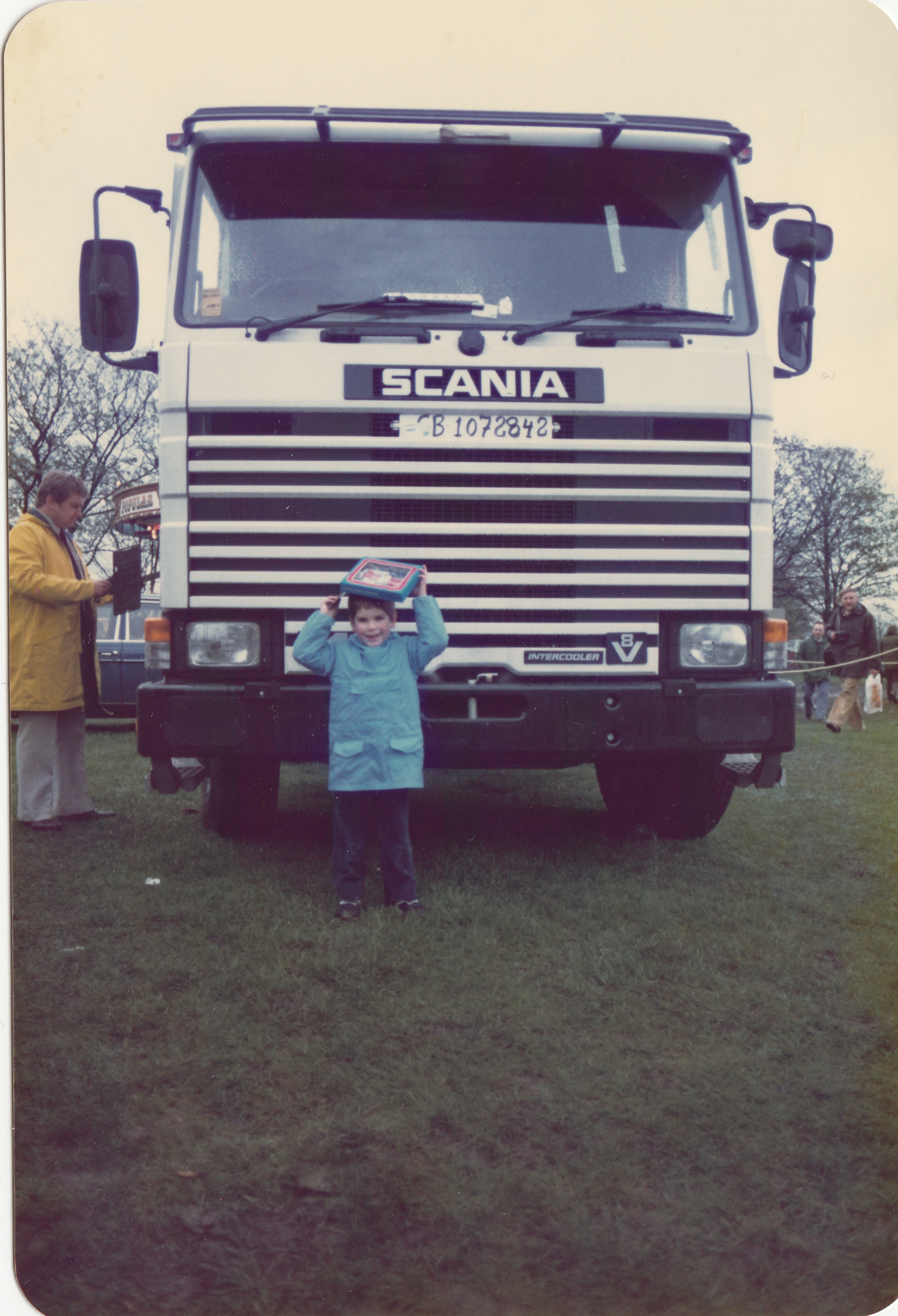 Christopher Kelly in front of a Keltruck Scania V8 tractor unit at Truckfest in 1983.