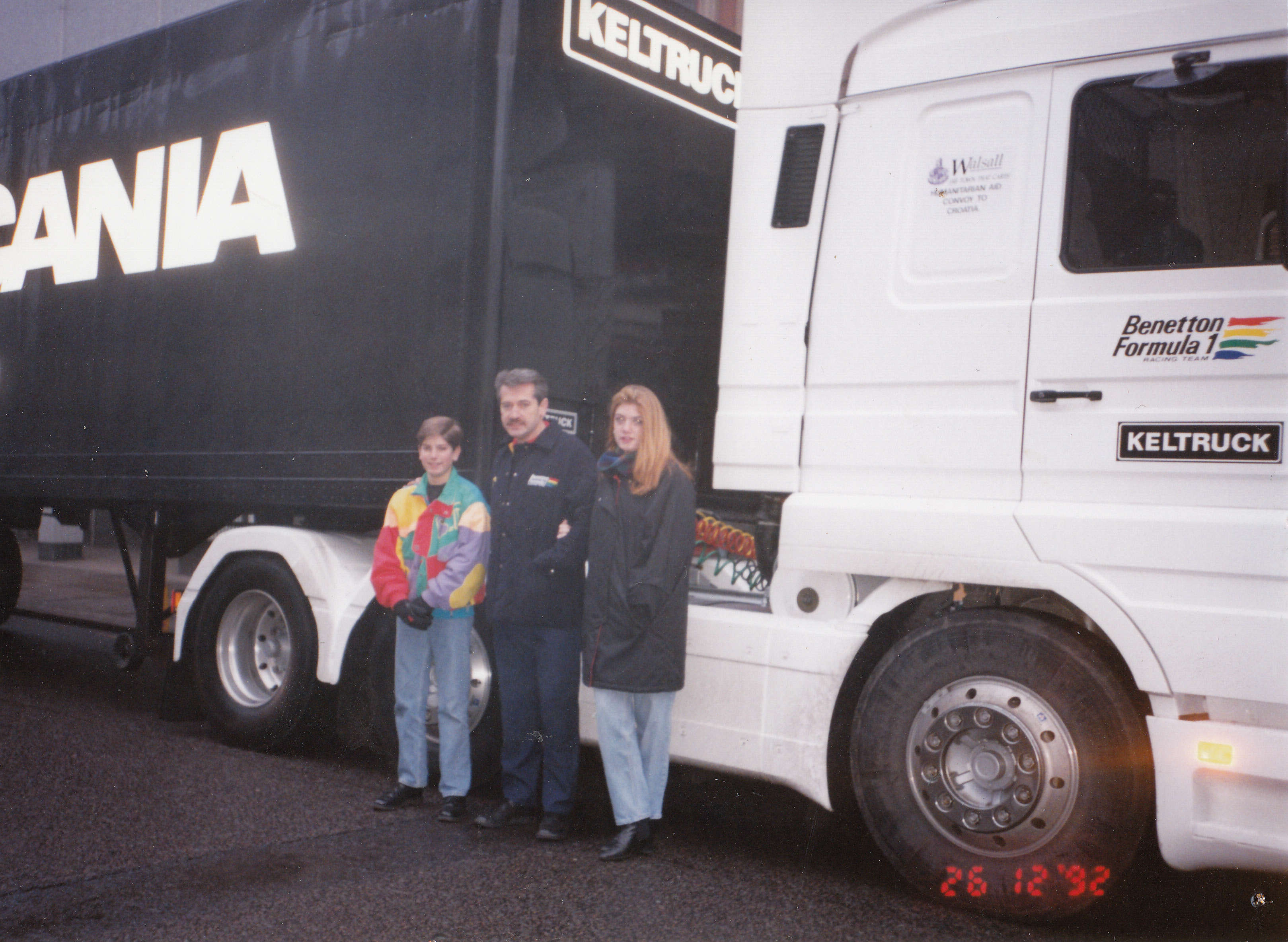 Keltruck supported the successful Benetton Formula 1 team. Here we see founder (then Managing Director & Dealer Principal), Chris Kelly and his children on Boxing Day in 1992 as one of the Benetton team F1 Scania Streamline vehicles leaves Keltruck's West Bromwich head office on a mercy mission hauling – in often sub-zero temperatures – emergency supplies to ill-equipped orphanages in the former 'Soviet bloc' as several eastern European countries collapsed into chaos following the bringing down of the Berlin Wall and the ending of the division of the continent of Europe. Chris was at the wheel all the way there & back.